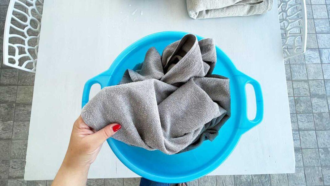 lavare-sabbia-teli-mare